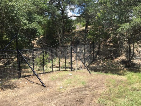Aim High Fence Builders - Texas Ranch Metal Pipe Water Gap Fence Construction