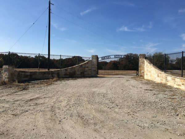 Aim High Fence Builders - Texas Ranch Rock & Metal Entrance, Custom Gate