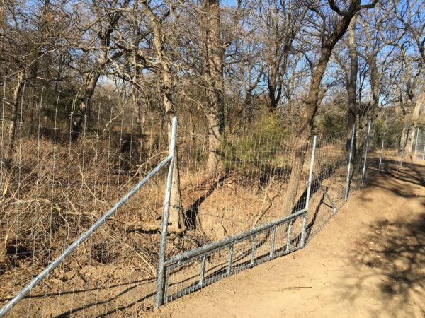 Aim High Fence Builders - Texas Metal Pipe Water Deer & Exotic Game High Fence Gap Construction