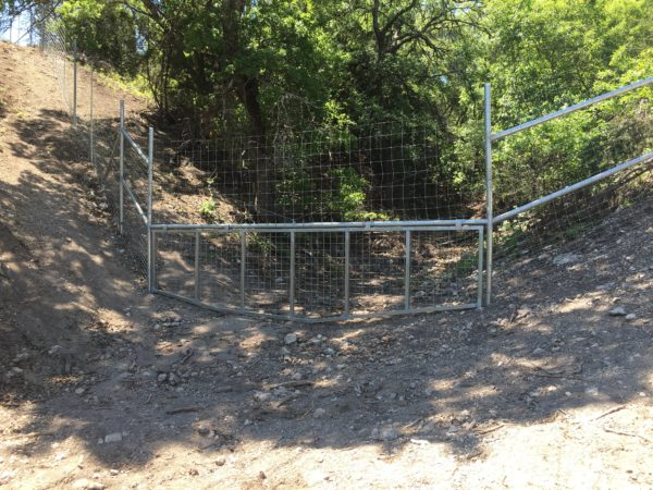 Aim High Fence Builders - Texas Exotic Game Ranch Metal Pipe Water Gap Construction